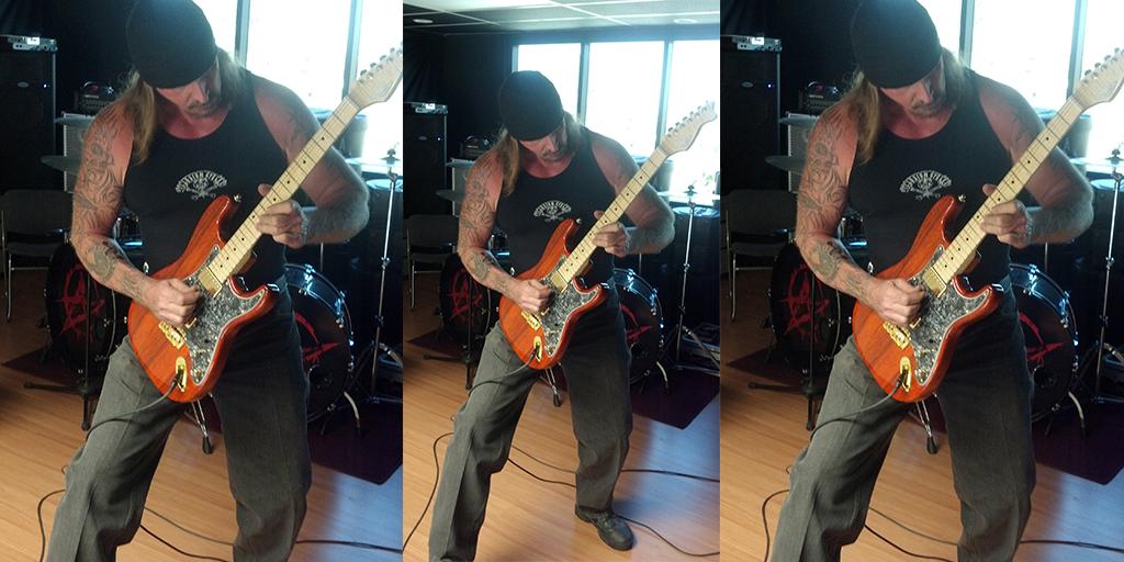 Rusty Coones, from Attika 7, playing RH Custom Guitar